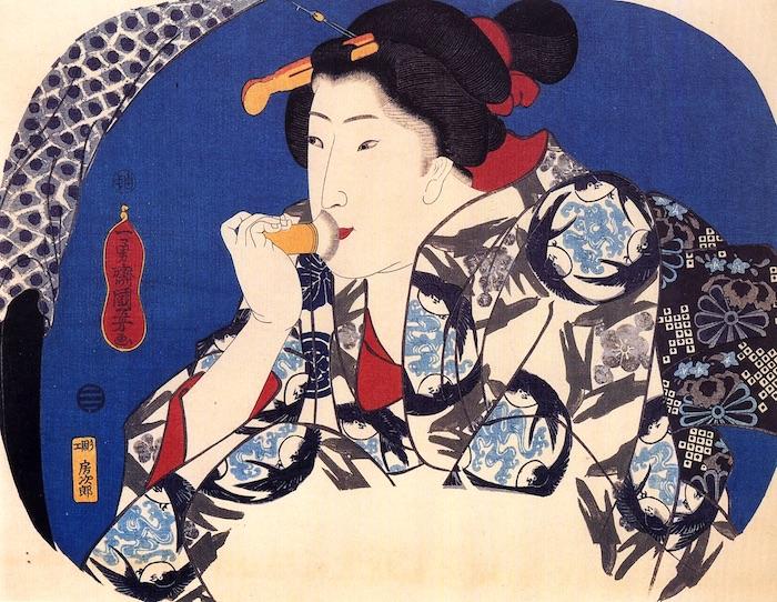歌川国芳の団扇絵で、団扇絵の画面を鏡に見立て化粧をする女性を描いたユニークなもの