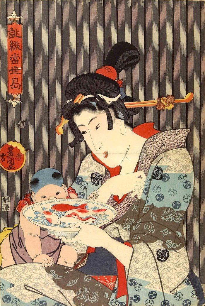 金魚をかたどった「金華糖」という砂糖菓子を見る子ども(『誂織当世縞』歌川国貞 画)の拡大画像
