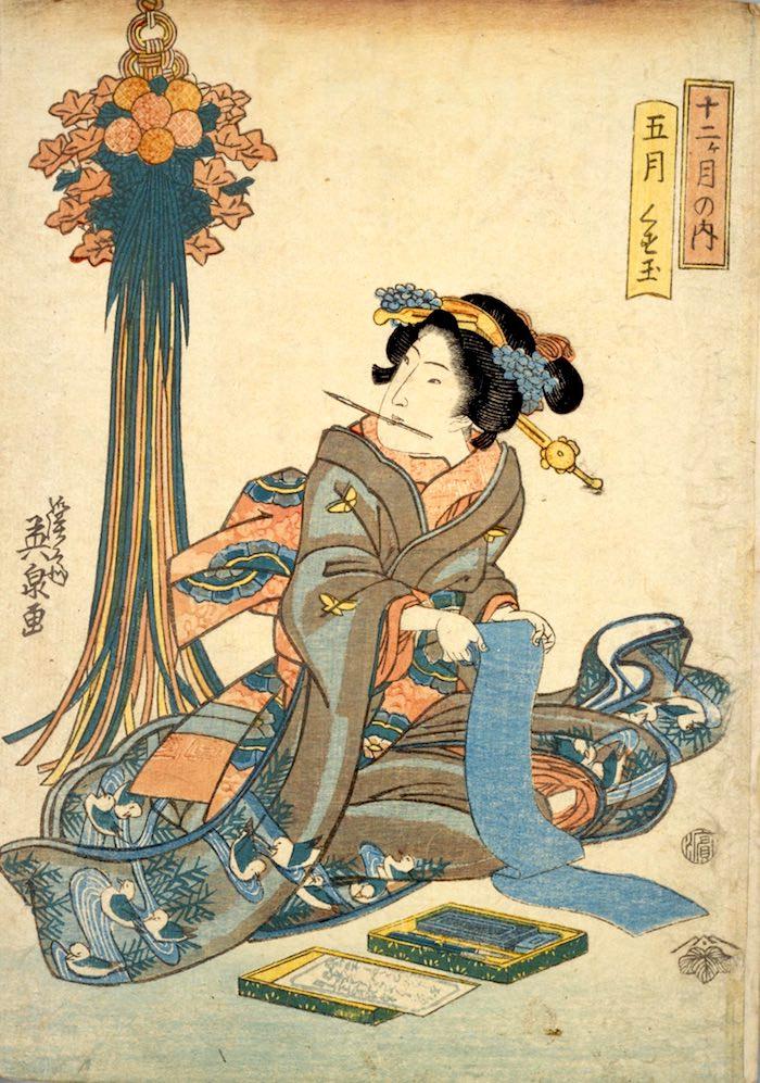 菖蒲の葉でつくった薬玉を見る女性(『十二ケ月の内 五月 くす玉』渓斎英泉 画)の拡大画像