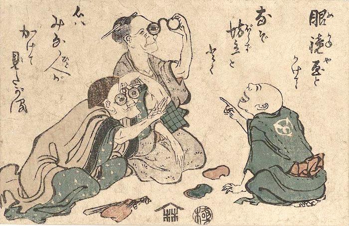 眼鏡を試す江戸時代のおじいちゃんとおばあちゃん(葛飾北斎 画)