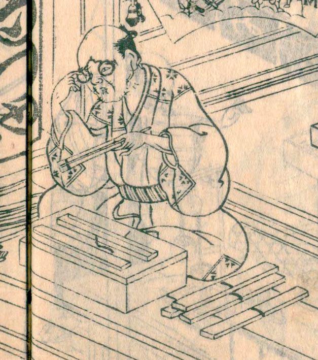 江戸時代、店先で扇を売る扇屋の主人。手持ちタイプの眼鏡を使用中(『絵本御伽品鏡』より)の拡大画像