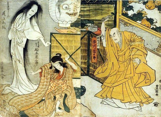 菊に取り付いた累の怨霊(左)と対峙する祐天上人(右)(歌川豊国 画)