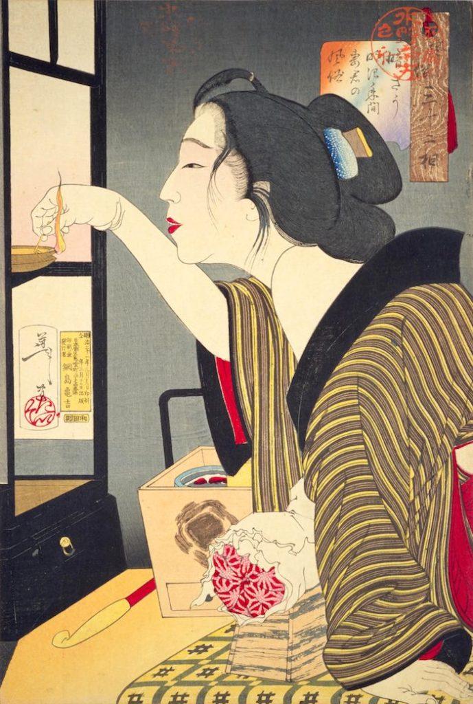 行灯のなかにある灯芯に火をつける女性(『風俗三十二相』「暗そう」月岡芳年 画)の拡大画像